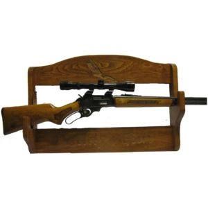 Personalized wooden wall rack deigned to hold a rifle.