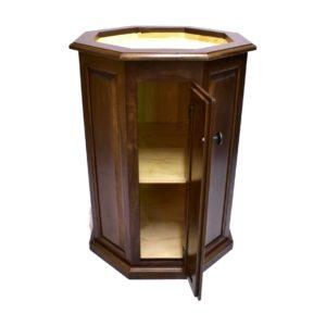 Walnut octagon pedestal with raised panels, doors.