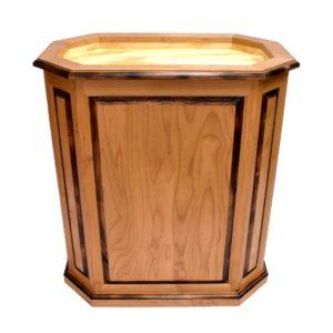 Burned alder octagon pedestal with raised panels, doors.