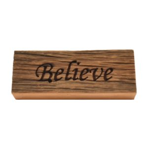 """Reclaimed barn wood block sign that reads, """"Believe""""."""