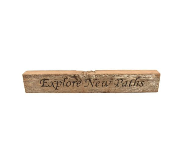 """Reclaimed barn wood block sign that reads, """"Explore New Paths""""."""