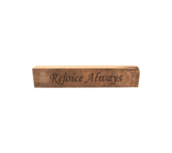 """Reclaimed barn wood block sign that reads, """"Rejoice Always""""."""