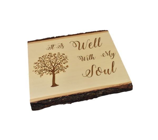 """Engraved live edge sign that reads, """"It Is Well With My Soul""""."""